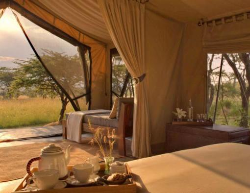 Naboisho-camp-guest-tent-interior-view-dawn-carousel